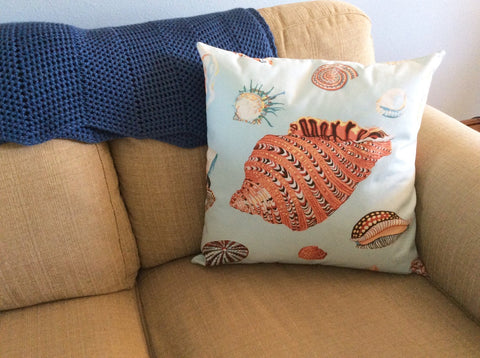 conch shell pillow by Kelley Chiavaroli