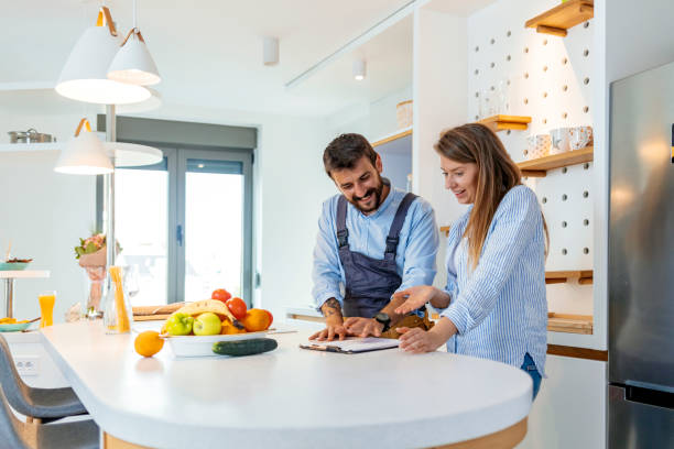 Man and woman standing at a kitchen counter