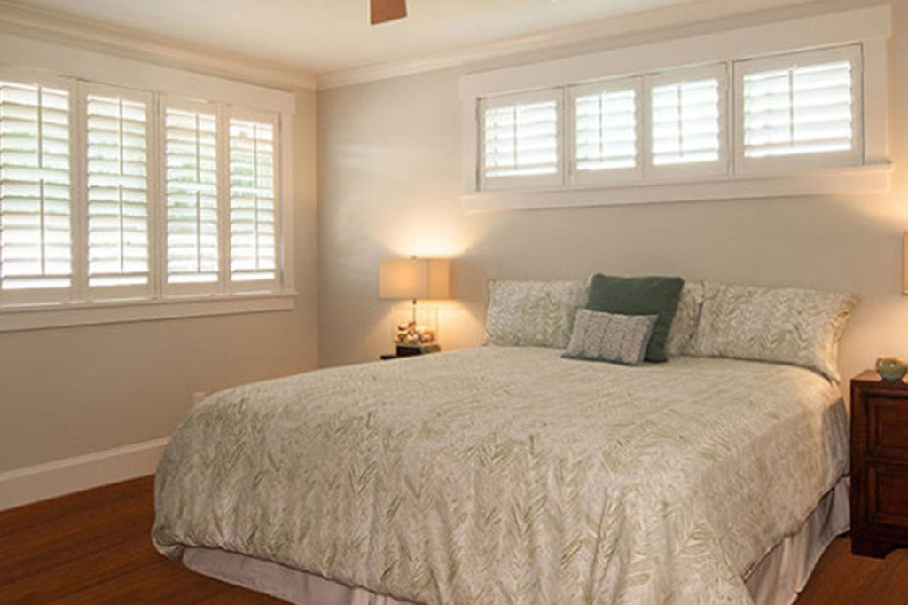 Soft bed linens or window shutters bedroom