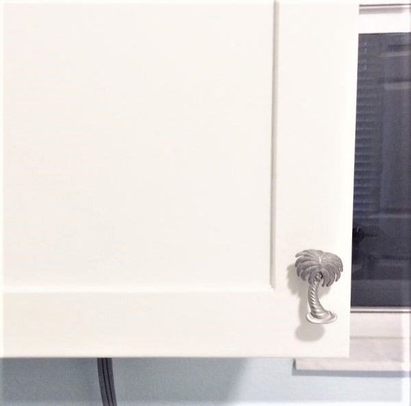 palm tree cabinet knob on white cabinet door