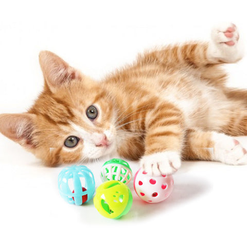 One pack Of 4 Piece MultiColored Different Sizes Bell Balls with A Variety of Patterns Fun Interactive Cat Toy For cats and kittens with kitten playing model