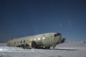A passenger airplane sits on snow.