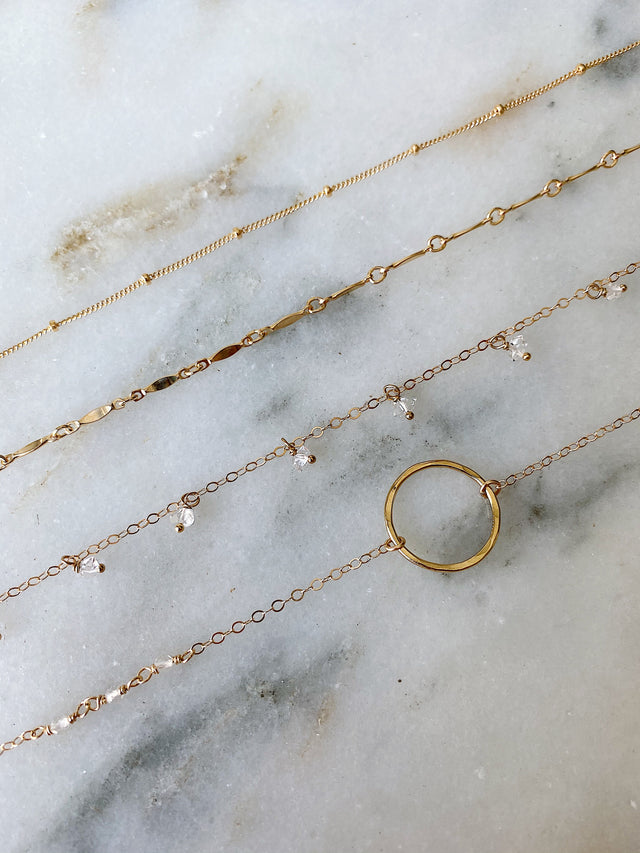Circle Necklace with Clear Quartz - Gold