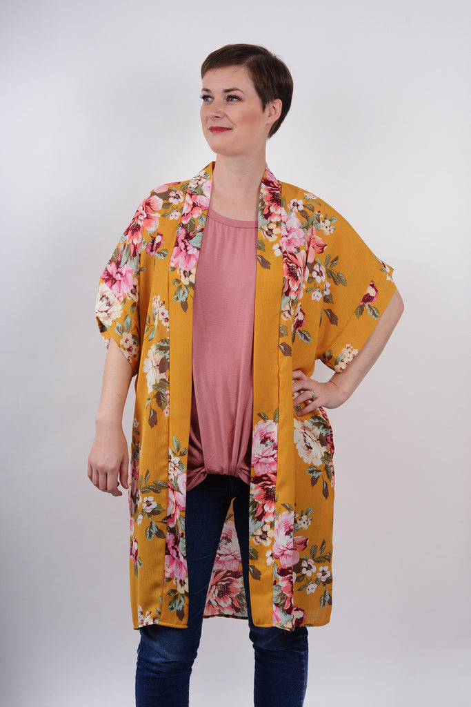 model wearing Mauve Knotted Drape front Tee and Mustard Kimono