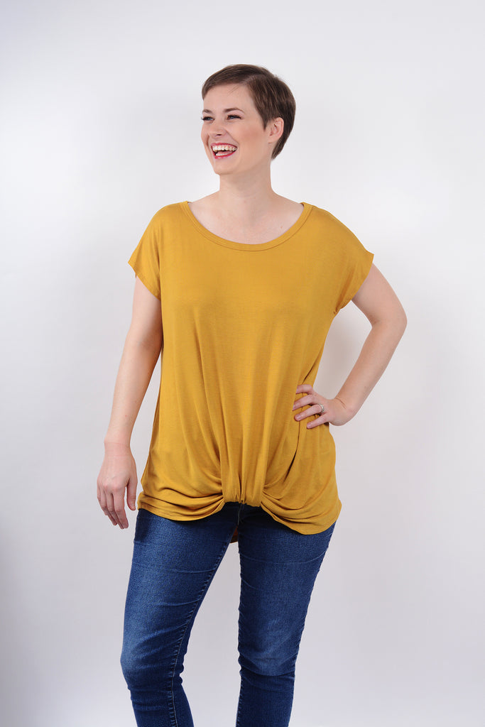 model wearing size S Lucky Franklin Knotted Drape Front Tee in Mustard