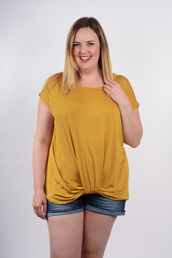 model wearing size 1X Lucky Franklin Knotted Drape Front Tee in Mustard