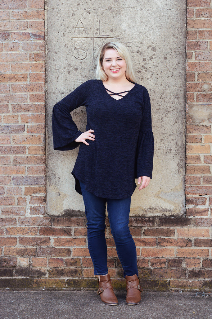 model wearing a size L Lucky Franklin Bell Sleeve Sweater in Navy