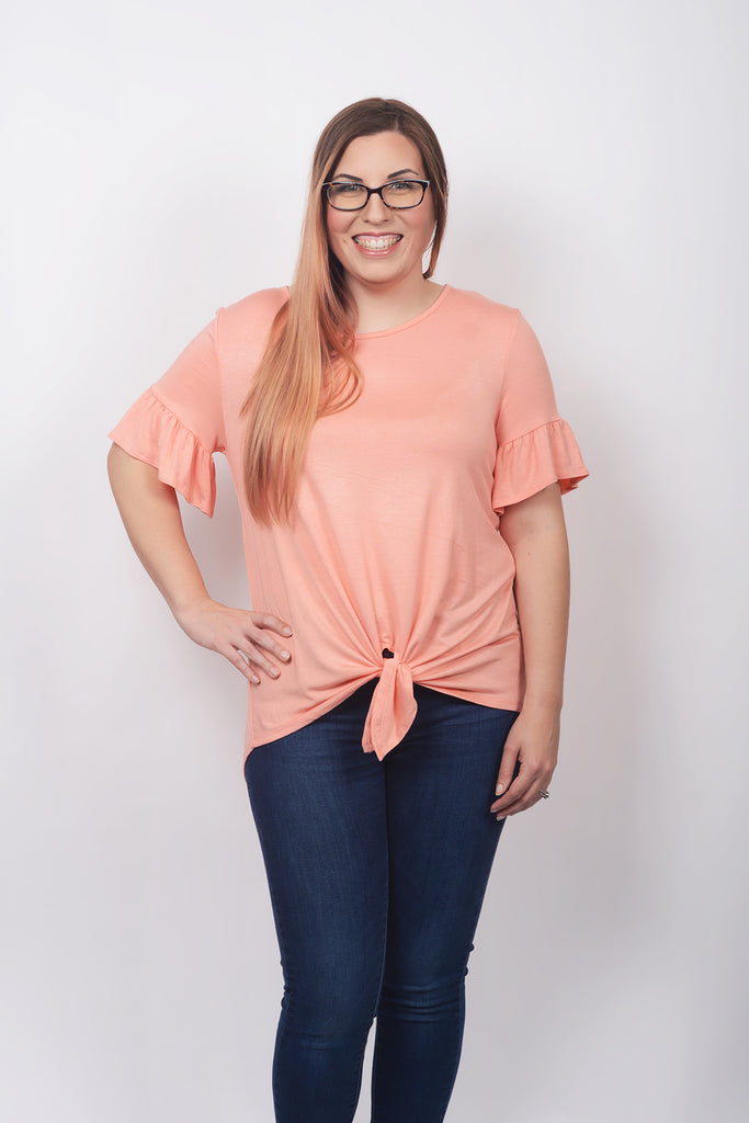 model wearing size M Lucky Franklin Solid Tie Front Tee Peach