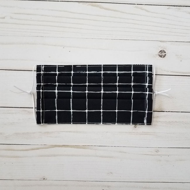 Handmade premium 100% cotton reusable fabric face mask pleated with adjustable elastic in black and white geometric grid print