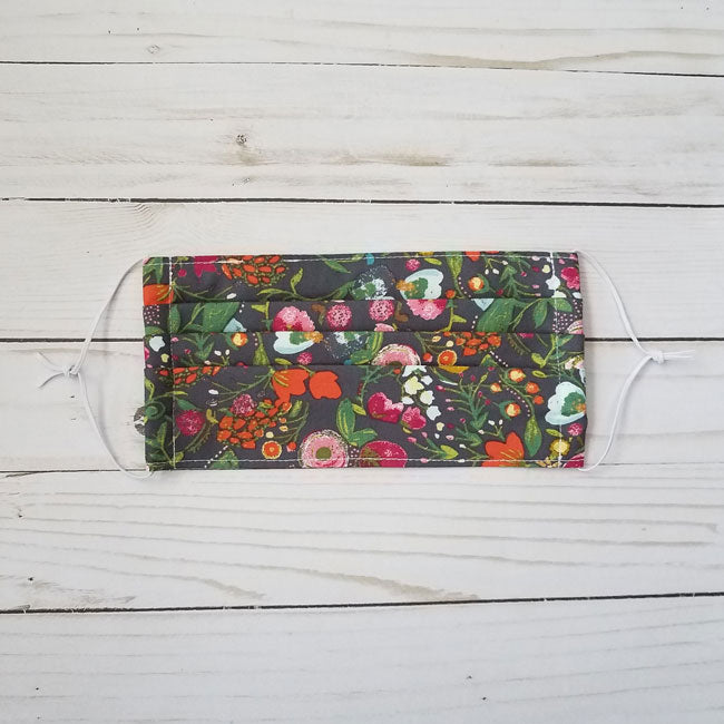 Handmade premium 100% cotton reusable fabric face mask pleated with adjustable elastic in bright pink, blue and charcoal grey watercolor floral print