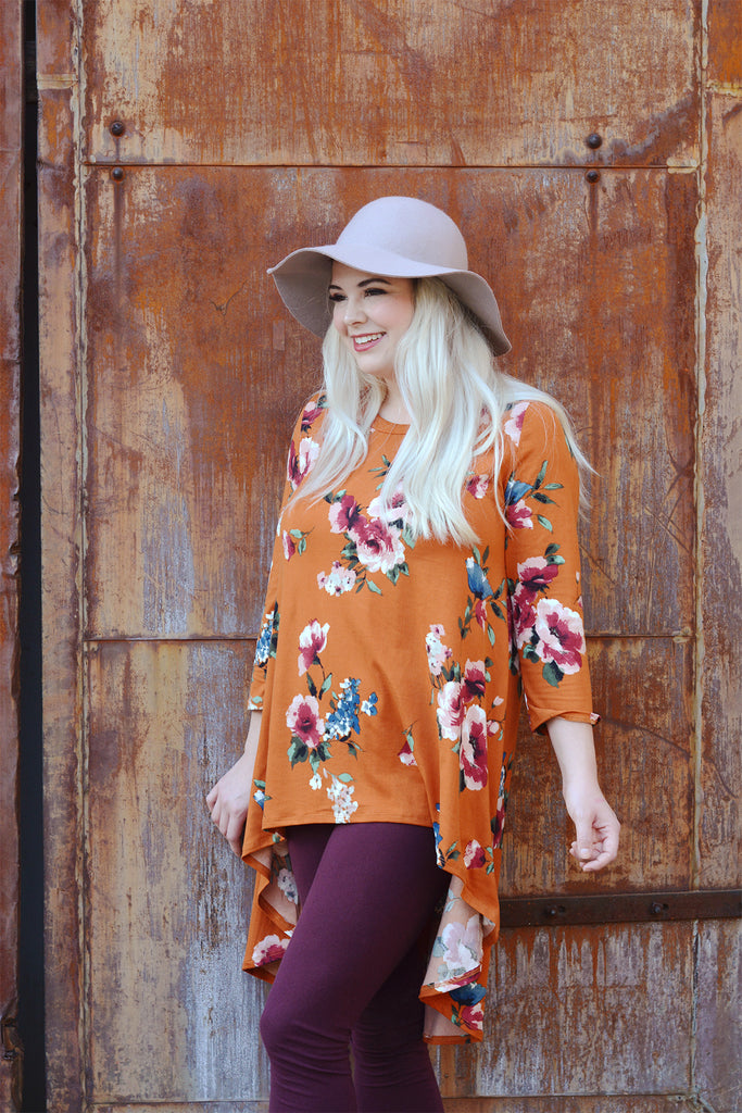 model wearing a size L Lucky Franklin Floral Hi Lo Tunic in Rust