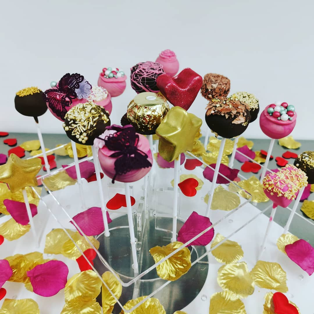 Cake pop stand full of different designs of cake pops