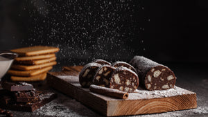 Salami shape rich chocolate treat with biscuits and different flavours.