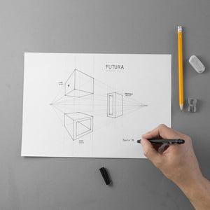 Design on paper of the FUTURA necklaces' project with a hand that draws, eraser and sharpener.