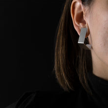 Load image into Gallery viewer, woman are wearing Silver Square Earrings with black background