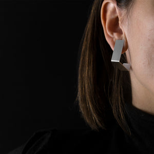woman are wearing Silver Square Earrings with black background