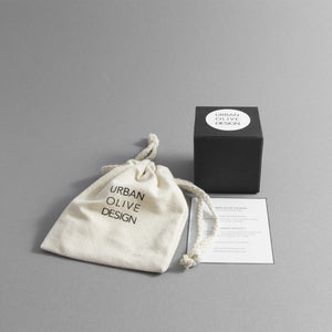 Gift box with a Certificate of Authenticity and a drawstring pouch made of organic cotton