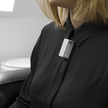 Load image into Gallery viewer, A woman with a blond hair wearing the Grey Rectangle Necklace with a black bluse on a grey background