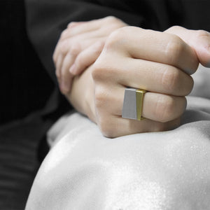 close-up of hand are wearing the Assembled ring, a combination of Aluminium square ring and brass square ring