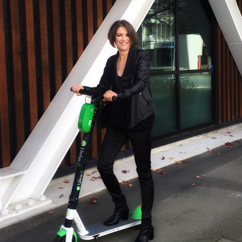 Bronwyn Sheehan on a lIme scooter in central Christchurch