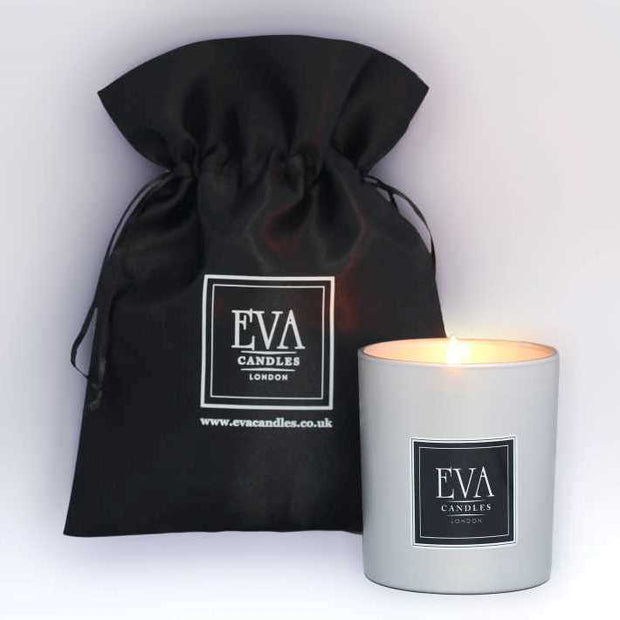 Photo of Ylang Ylang candle in satin black bag, Luxury gift from London, scented candle made in UK, luxury home decor, non toxic scented with pure 100% natural essential oil, vegans friendly, oil, long and clean burn, suitable for vegans, Eco friendly, glamorous gift for her. for any occasion, perfect present from London UK, luxury home treat, hand-poured product.