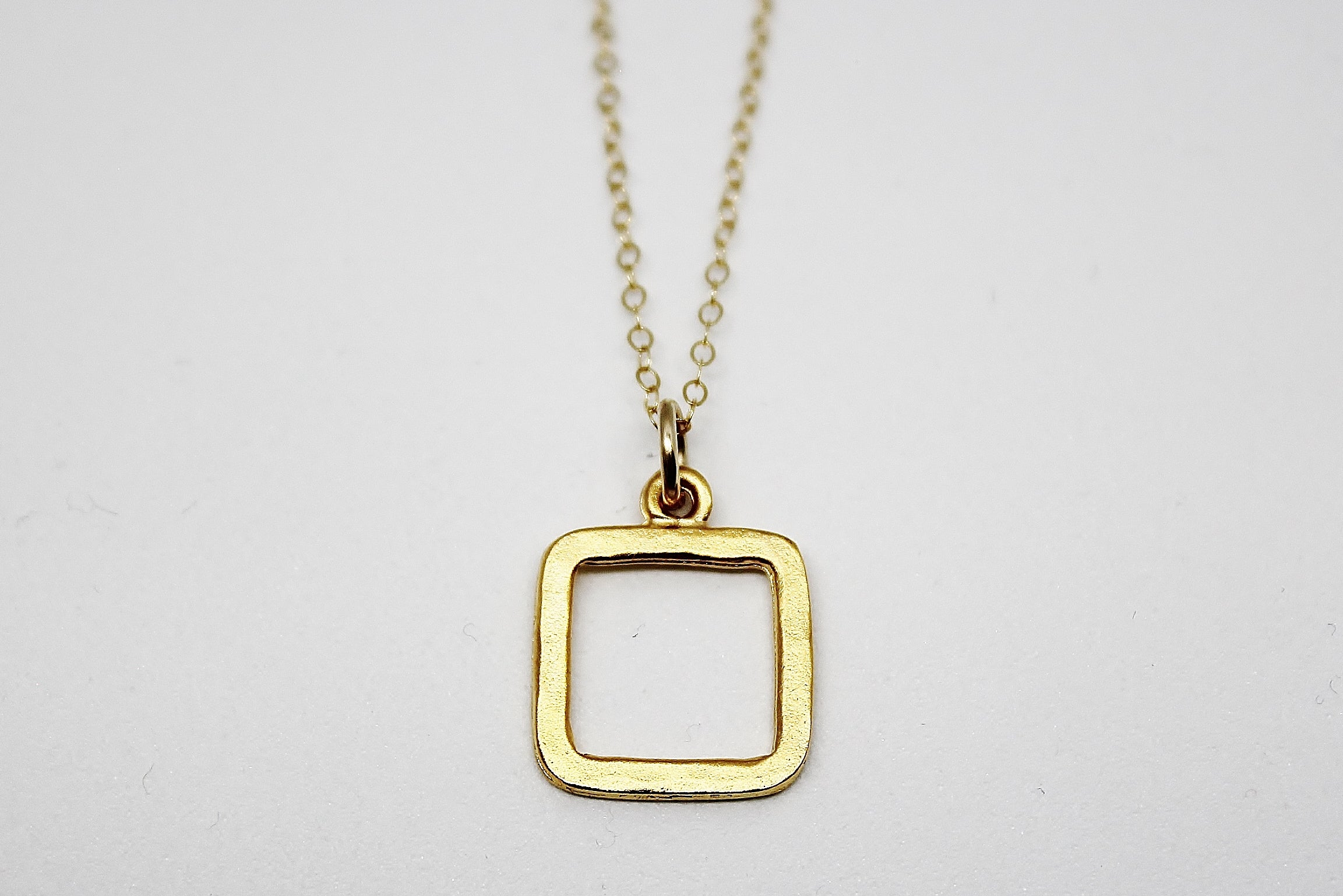GOLD SMALL SQUARE PENDANT