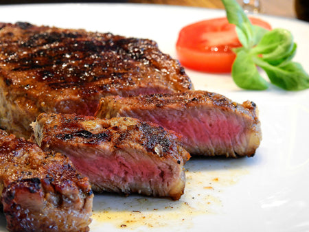 Raw or undercooked steaks are foods to avoid while pregnant.