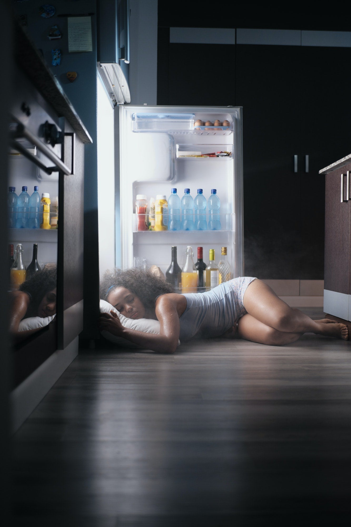 A woman experiencing night sweats post childbirth.