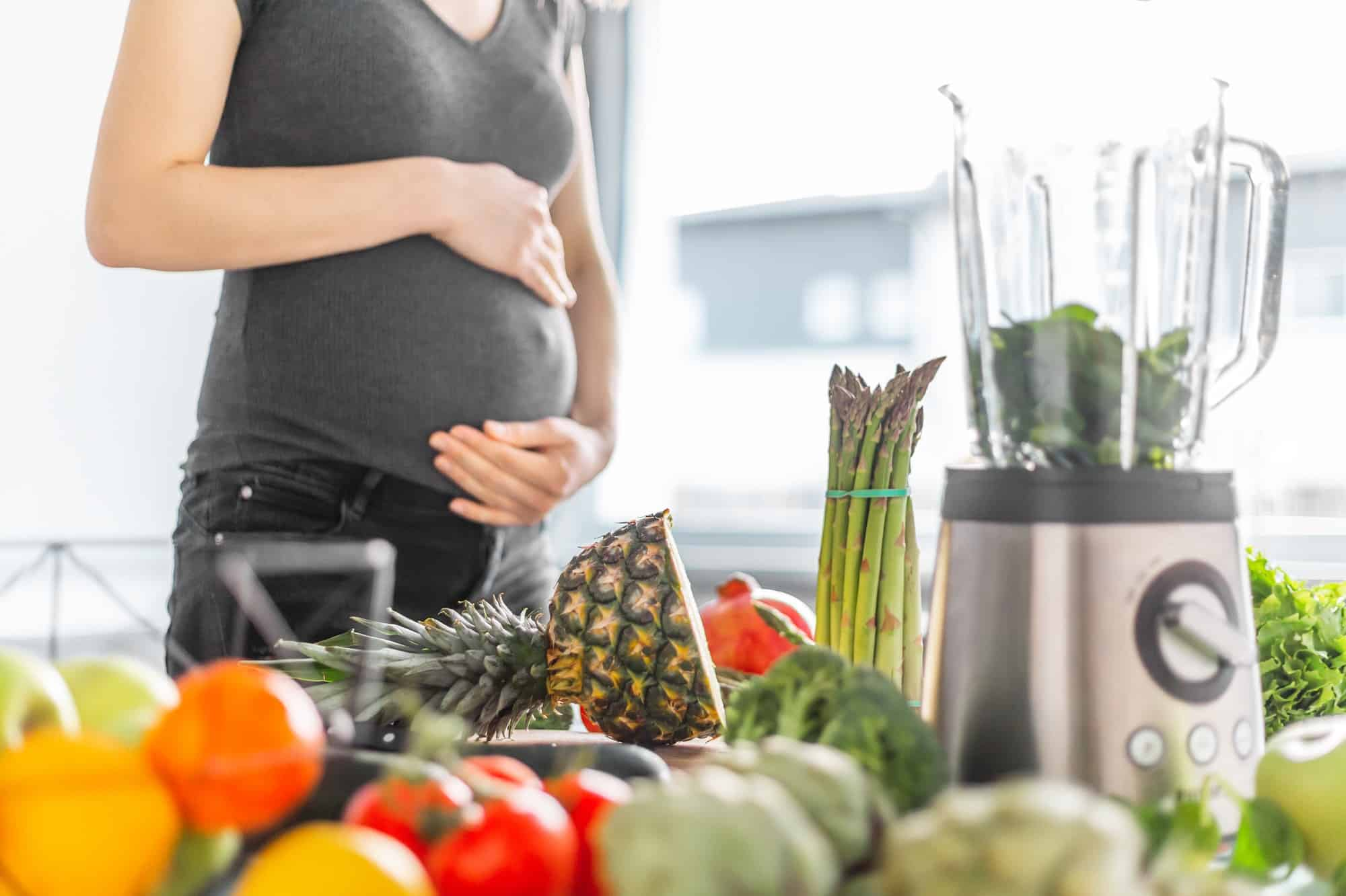 Pregnant woman cooking healthy food