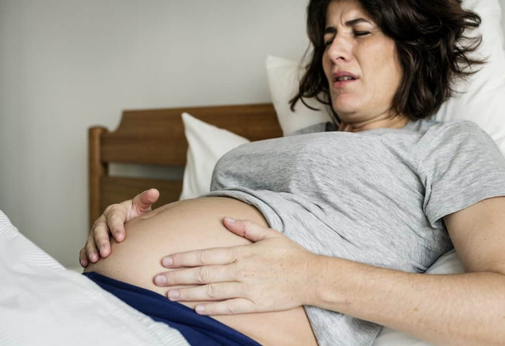 Woman experiencing labor pains