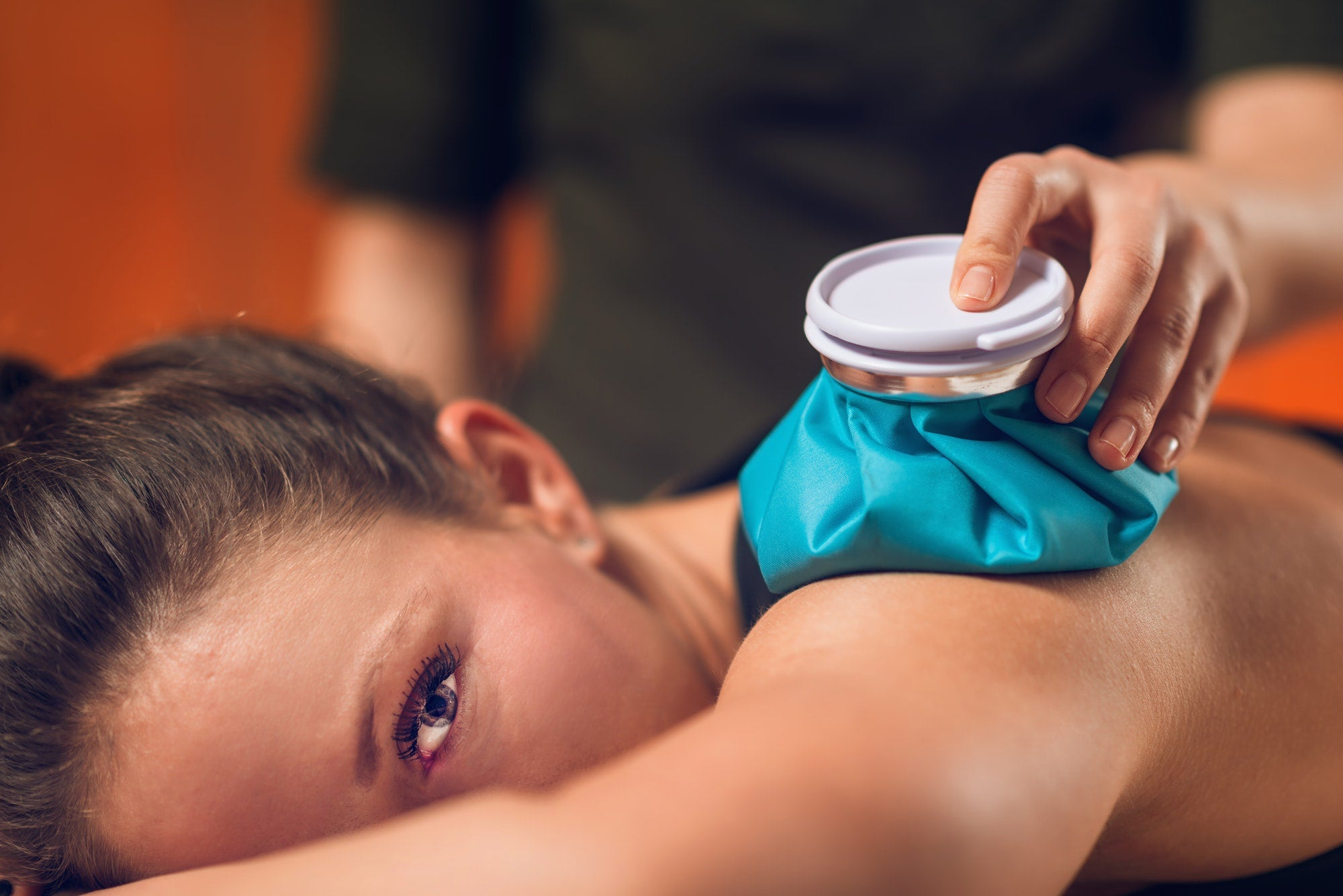 A woman using an ice pack.