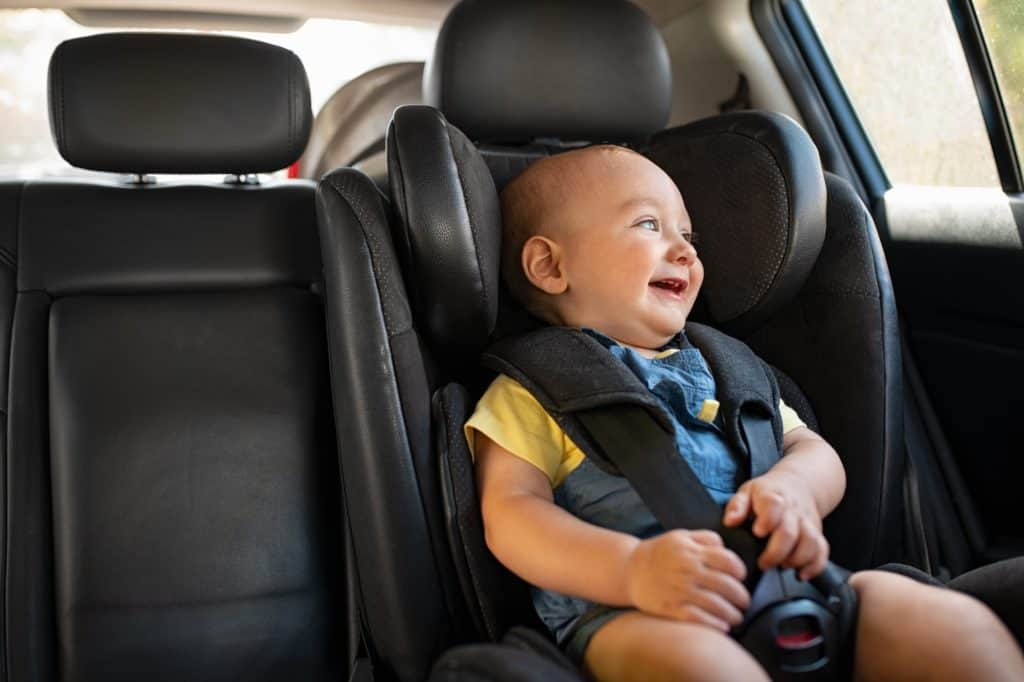 Toddler sitting in a car during road trip