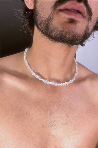 A close chain strung with uncut organic shaped Herkimer diamonds forming an ethereal crystal necklace.