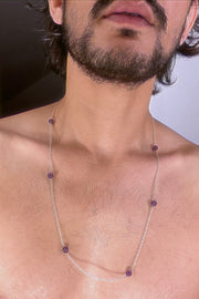 An amethyst bead necklace strung in silver.