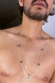 A labrodorite bead necklace strung in silver.