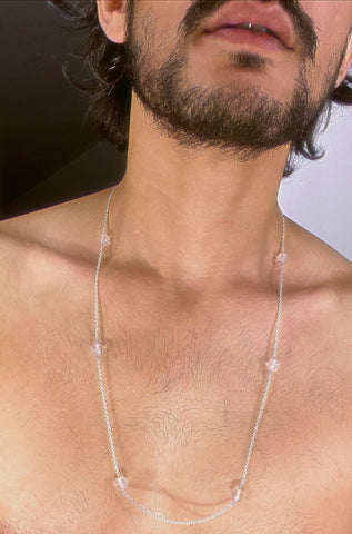 A rose quartz bead necklace strung in silver.