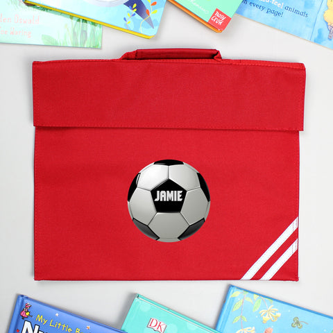 Red book bag featuring a Football design with personalised name
