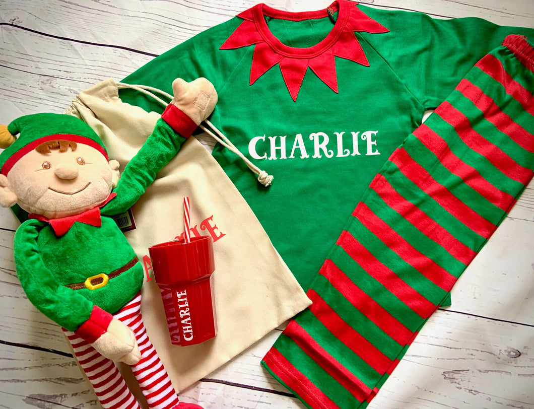 personalised Elf pyjamas, Elf soft toy and personalised red cup, personalised drawstring bag