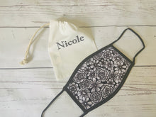 Load image into Gallery viewer, Black and white floral design face mask covering with personalised storage bag