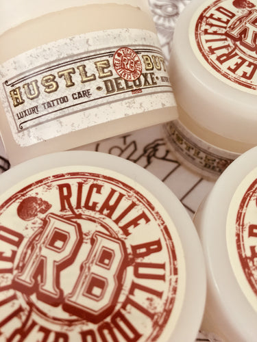 Original Hustle Butter Deluxe Vegan & Cruelty Free natural, organic tattoo aftercare balm in 1oz & 5oz tubs
