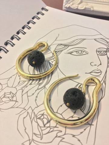 Brass hoop ear stretcher weight with volcanic lava rock suspended inside. Available in 1.2mm, 4mm & 6mm