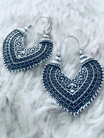 White brass vintage ethnic style antiqued heart shaped hoop earrings for pierced ears or to wear as fancy tunnel jewellery in stretched lobes. Sold in pairs.