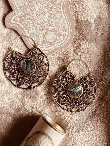 Antiqued sliver white brass Lotus flower hoop earrings with real abalone shell centre inlay. Sold in pairs, approx. size 60mm x 60mm suitable to wear through stretched ears or in standard pierced ears.