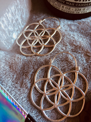 Flower of Life sacred geometry design white brass silver colour hoop earrings suitable for standard pierced ears or to wear as fancy tunnel drop jewellery through tunnels or ear saddles in any size stretched lobe. Sold in pairs.