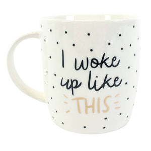 """I woke up like this"" slogan white ceramic mug with black spots/dot detail. Comes gift boxed."