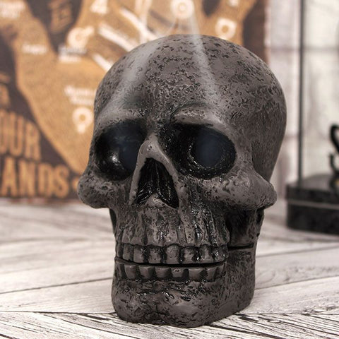 Resin skull incense cone holder/burner. Place a lit incense cone on the tongue and watch the smoke drift from the skull's empty eye socket! Ultimate goth gift for incense lovers!