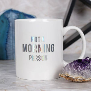 "Rainbow oil slick holographic iridescent ""Not A Morning Person"" slogan white ceramic mug."