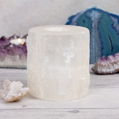 Selenite crystal round/cylindrical tealight candle holder for cleansing and purifying with single tea light candle.