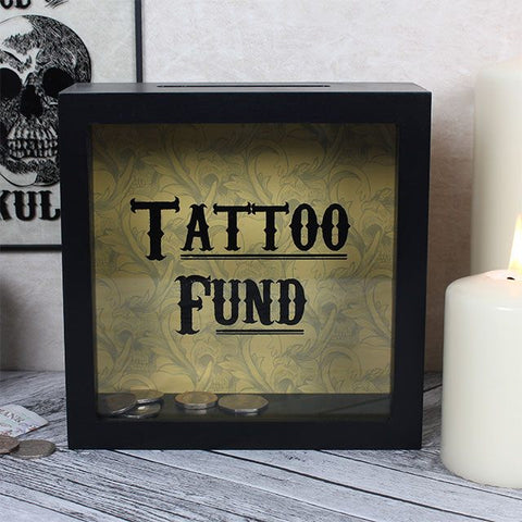 "Save for your next tattoo in style with this ""Tattoo Fund"" slogan shadow box frame type tattoo savings money box."