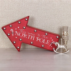 This Way TO The North Pole red arrow illuminated LED battery operated Christmas wall or free standing sign.